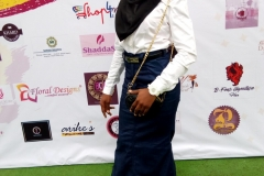 Miss Kafayat Lawal on the green carpet at the House of Nifemi Trade Fair, Lagos