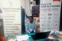 Mr. Olamide poses for a shot at Stephil Consults' stand during Meadow Hall Foundation exhibition in Lagos