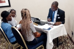 Stephil Consults' Senior Counsellor Mr. David Omowale attending to students at the 2018 Stephil Consults' Edu Fair at Radisson Hotel, Ikeja, Lagos.